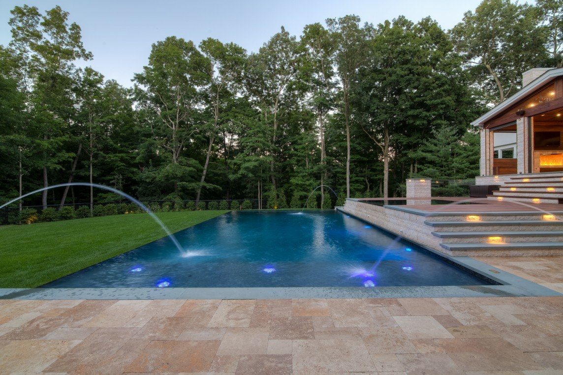 Infinity edge pool and outdoor living space neave group for Infinity swimming pool designs