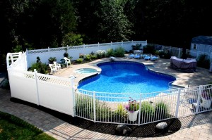 a fence enclosing a pool