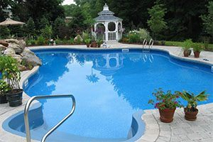 A pristine pool with a gazebo