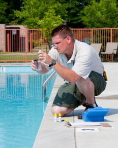 Man using a pool test kit